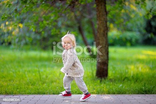 istock Toddler boy running in the park 485598334
