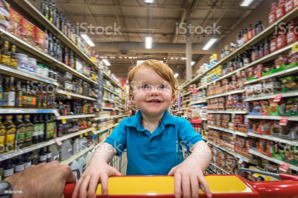 Toddler boy sitting in the shopping cart at supermarket - Royalty-free 12-17 Months Stock Photo