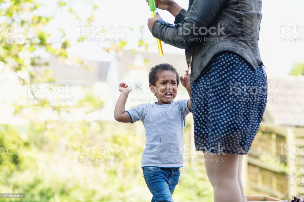 Toddler boy tantrum crying angry with mother stock photo