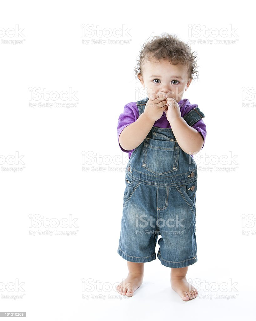 Toddler Boy with Shy Expression and Hands in His Mouth stock photo