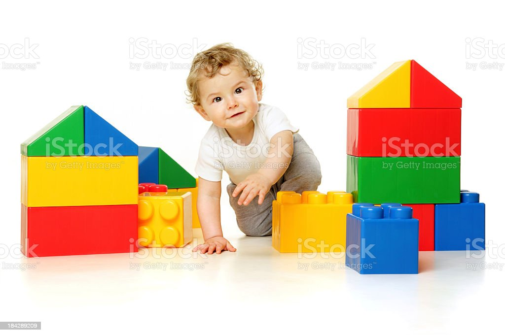 Toddler building with large blocks royalty-free stock photo
