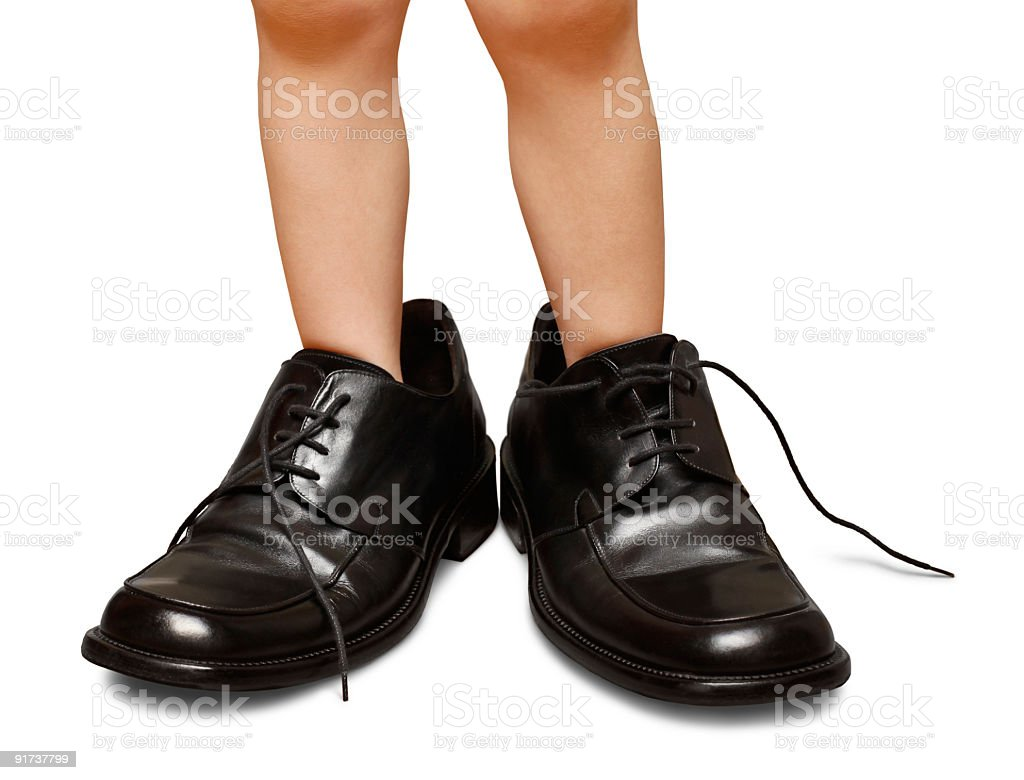 Toddler Childs Legs Wearing Oversized Mens Dress Shoes Isolated stock photo