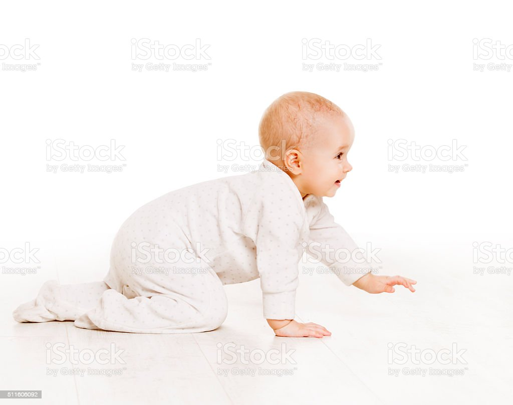 Toddler Crawling in White Baby Onesie, Active Kid Creeping stock photo