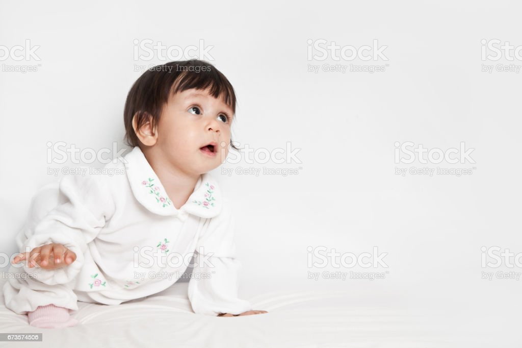 A Toddler crawling on floor stock photo