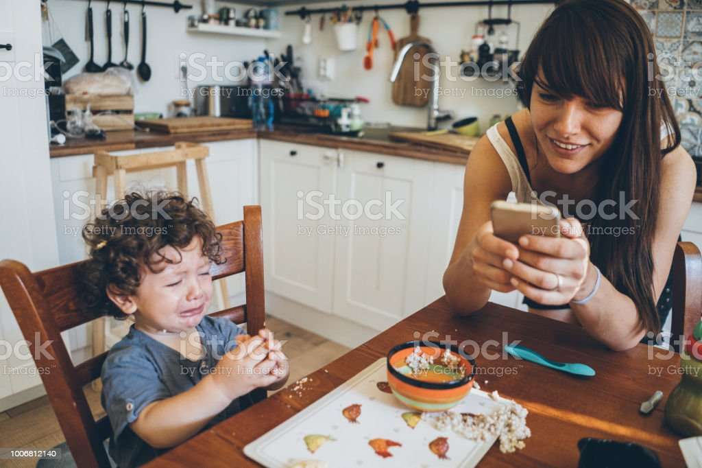 Toddler crying after making mess stock photo