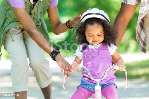 istock Toddler daughter learning to ride a tricycle 546005716