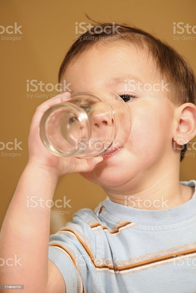Toddler Drinking from a Glass royalty-free stock photo