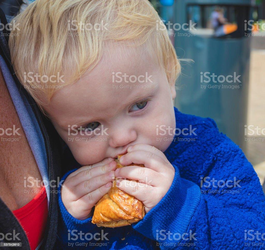 Toddler eating stock photo