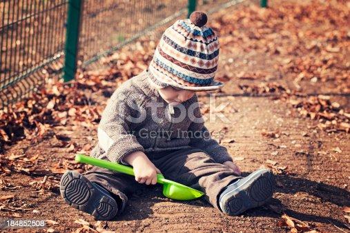 istock Toddler enjoy playing outdoors 184852508