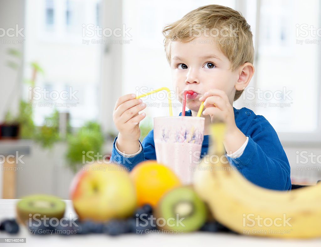 Toddler enjoying Fruit Shake Smoothie royalty-free stock photo