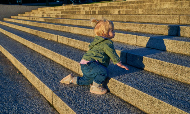Toddler Girl at the Lincoln Memorial with the Washington Memorial in the Background at Sunrise in Washington DC Capital of the USA stock photo