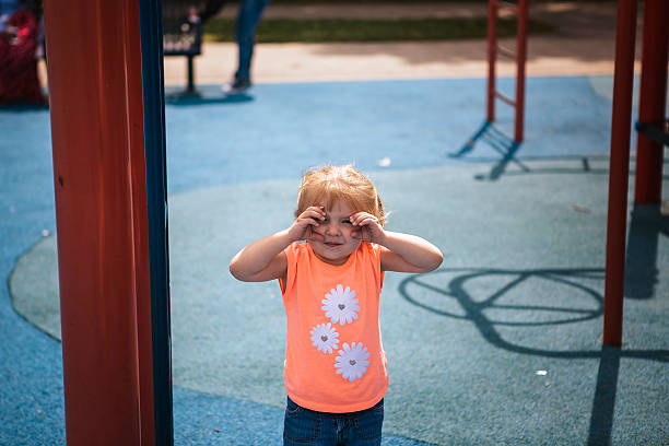 Toddler girl at the playground stock photo