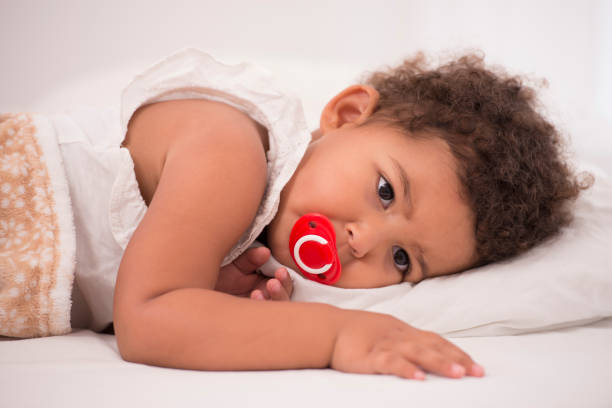 Toddler girl in bed time. stock photo