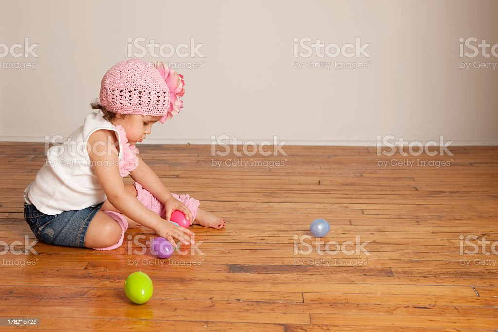 Toddler Girl Picking Up Easter Eggs royalty-free stock photo