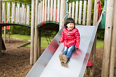 toddler girl play at Spring outdoor playground
