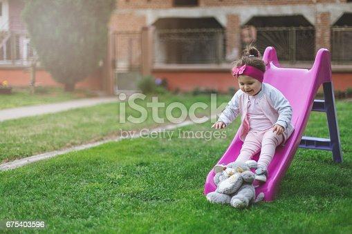 678589610istockphoto Toddler girl sliding 675403596