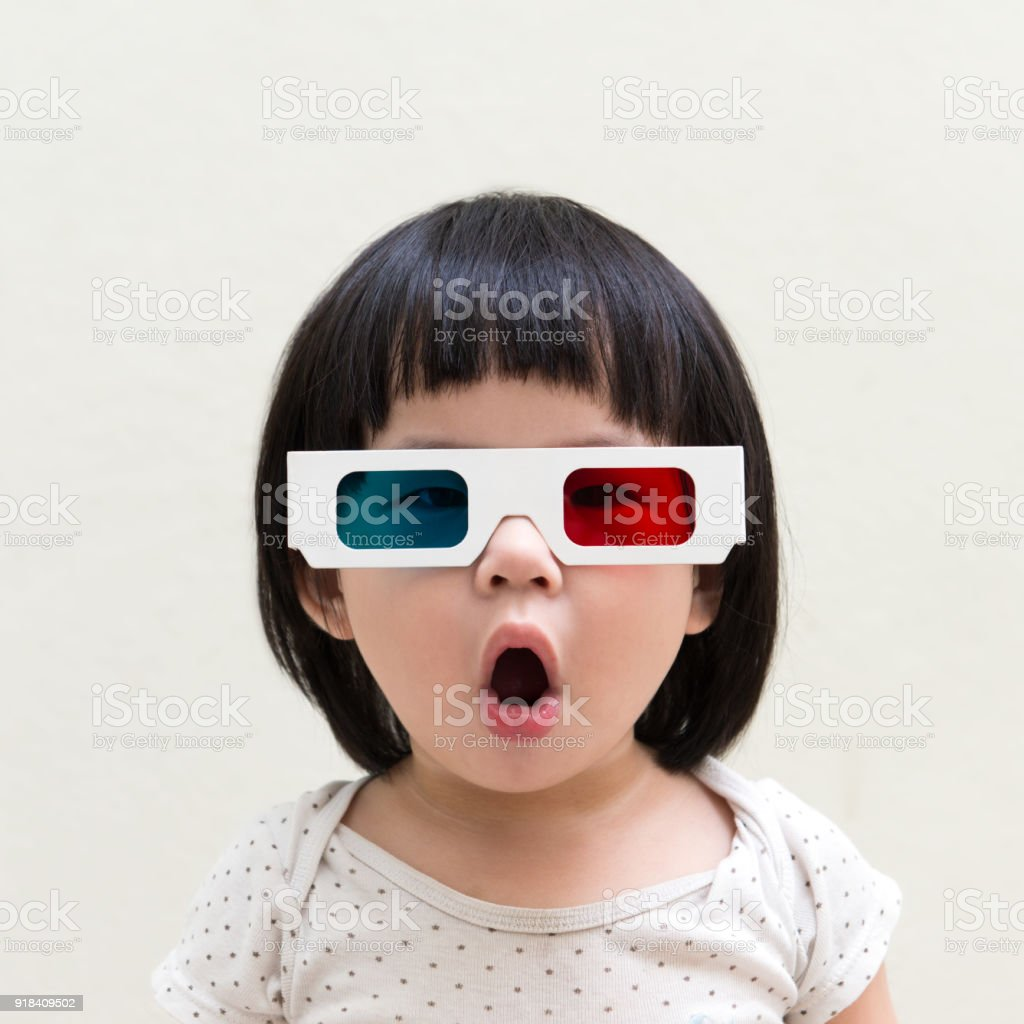 Toddler girl wearing 3d glasses stock photo