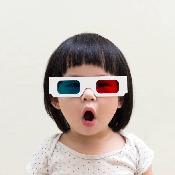 Toddler girl wearing 3d glasses stock photo