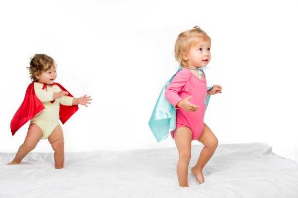 toddler girls in superhero capes - baby super hero imagens e fotografias de stock