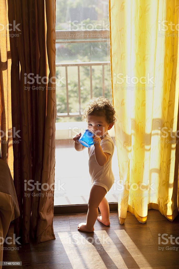 Toddler Greets the Brand New Day stock photo
