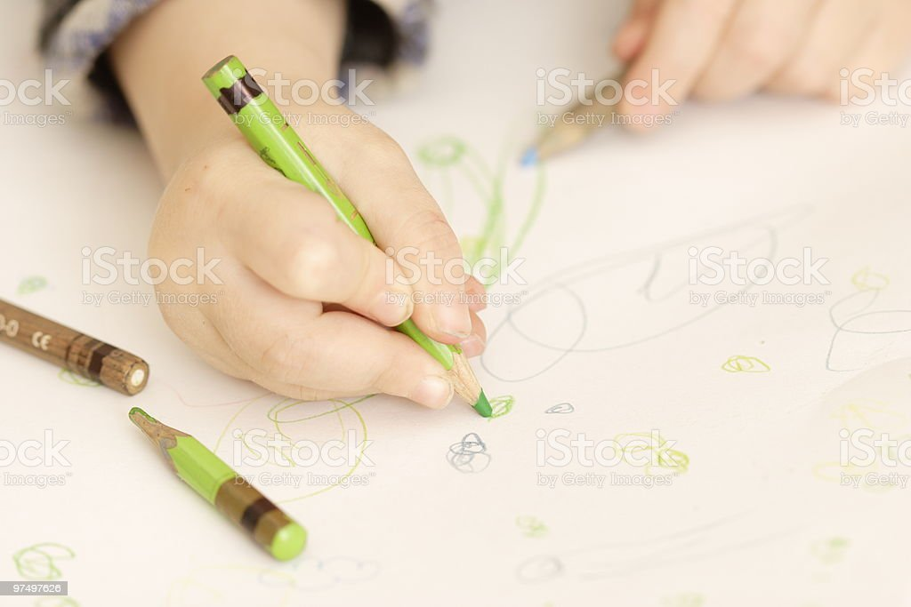 Toddler hands painting with crayons royalty-free stock photo