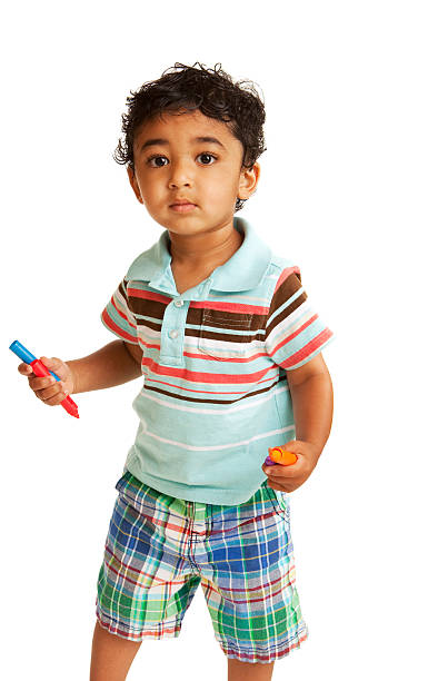 Toddler Holding Colorful Crayons stock photo