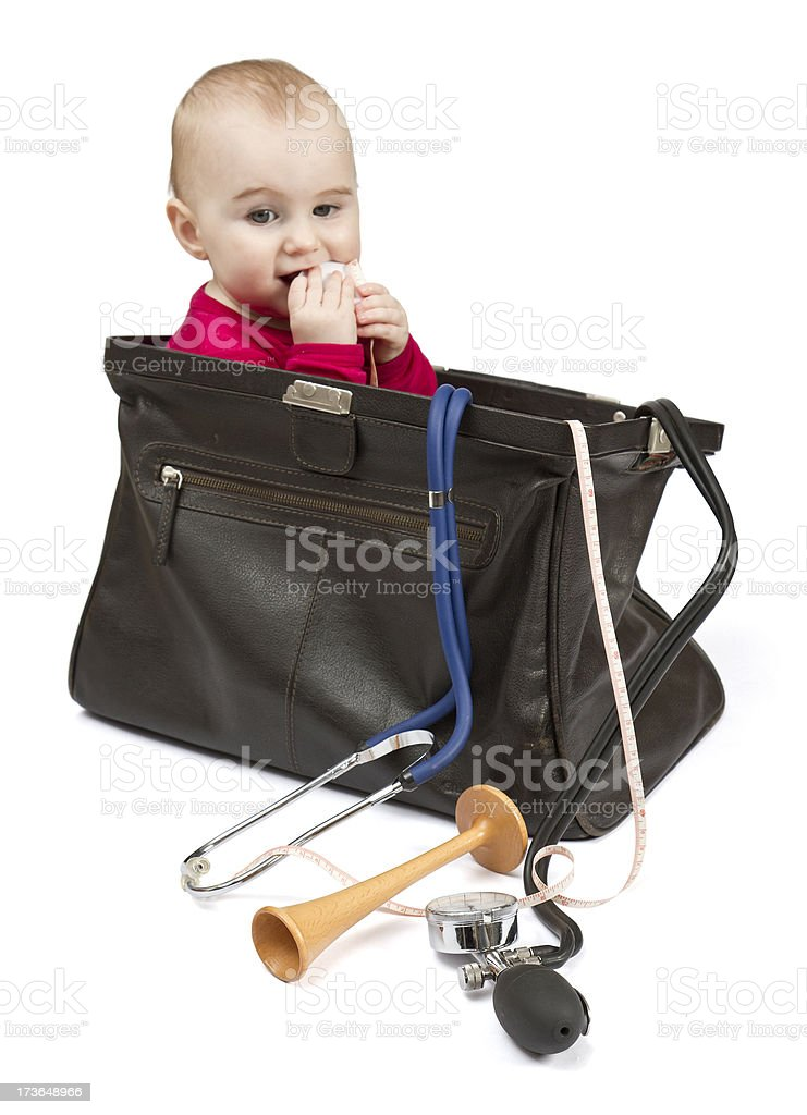 toddler in midwifes case stock photo