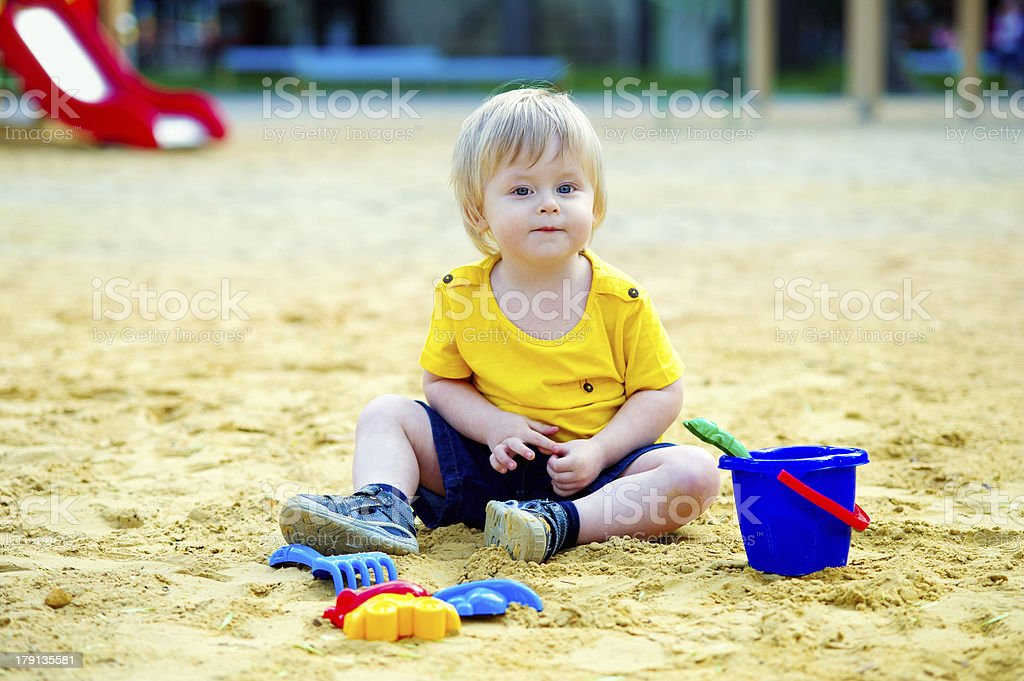 Toddler in the sandpit royalty-free stock photo