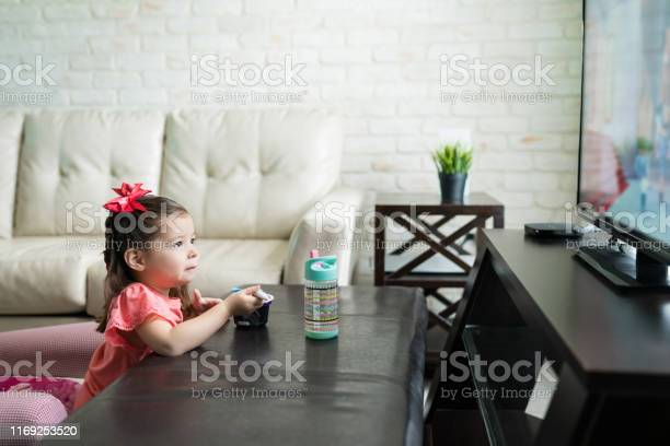 Toddler is enjoying tv and food at home picture id1169253520?b=1&k=6&m=1169253520&s=612x612&h=nf3y9ncewggp3q3s 0piexuzd0moxxd5e7a0xg5h5om=