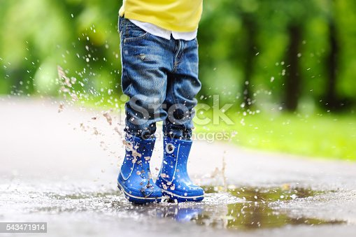 istock Toddler jumping in pool of water 543471914