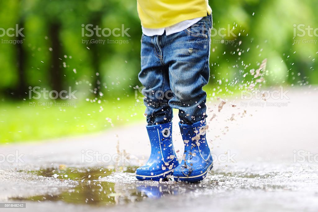 Toddler jumping in pool of water 스톡 사진