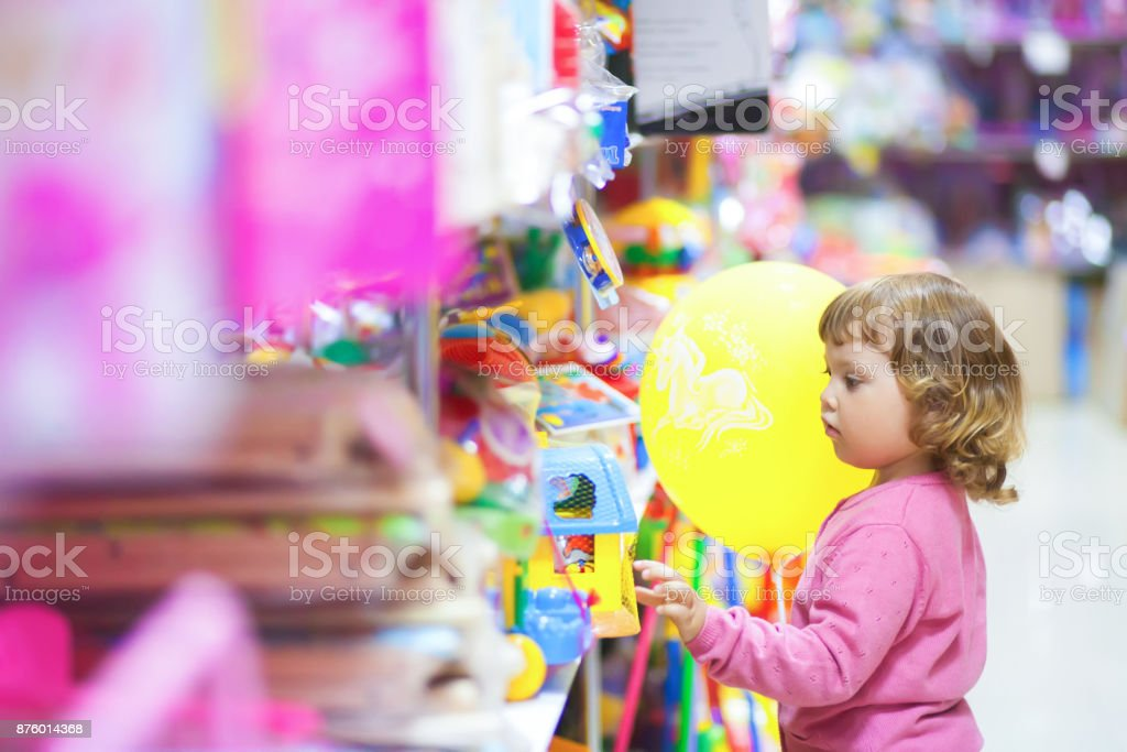 Toddler kid shopper at the toy shop. royalty-free stock photo