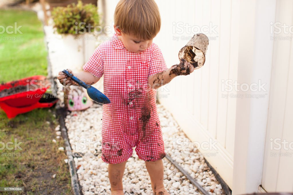 Little Boy Hiker Jumping Over Mud Stock Photo - Download