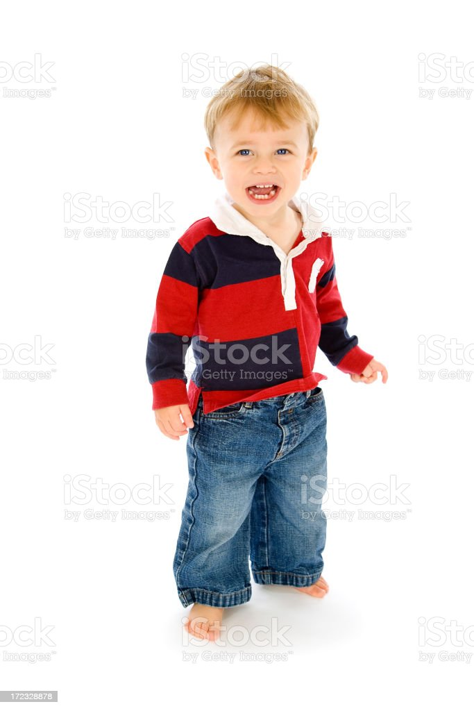 Toddler laughing standing on white background royalty-free stock photo