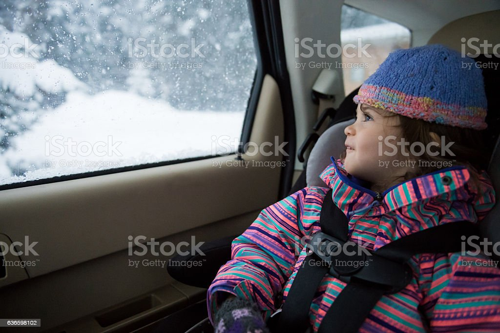 Toddler on a winter drive stock photo