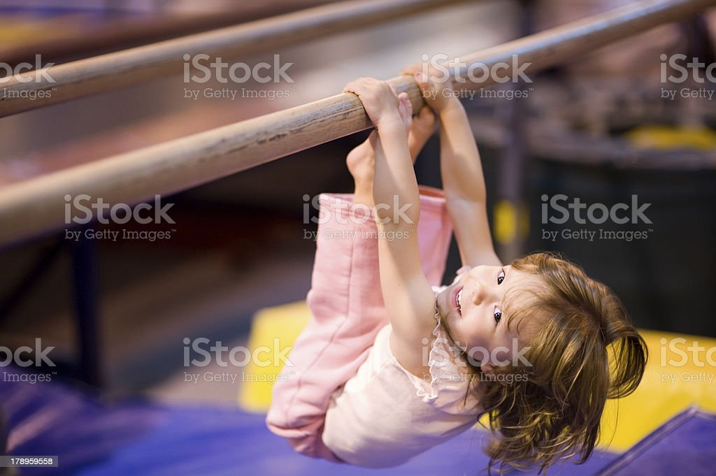 Toddler on Parallel Bars stock photo