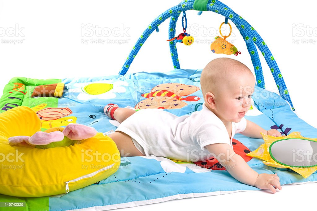Toddler on playmat royalty-free stock photo