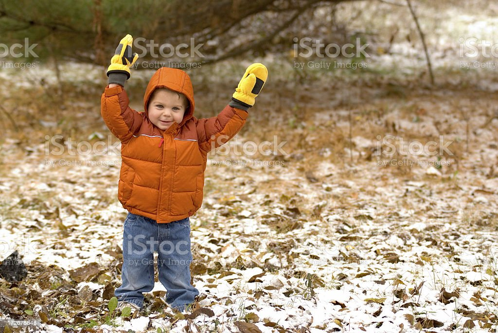 Toddler Playing, First Snow Of the Year royalty-free stock photo