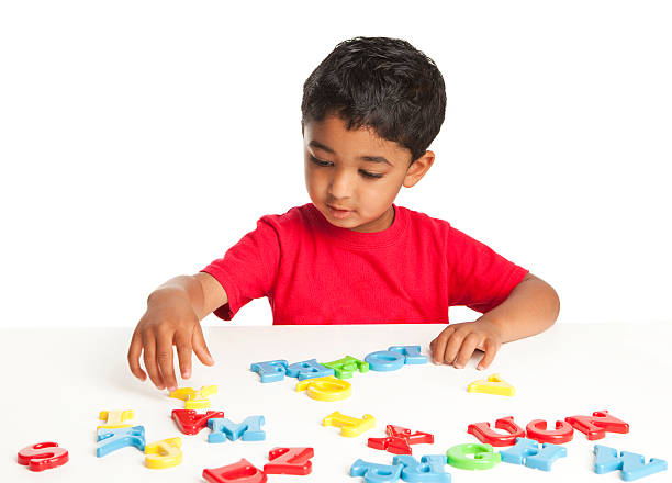 Toddler Playing with Alphabets stock photo