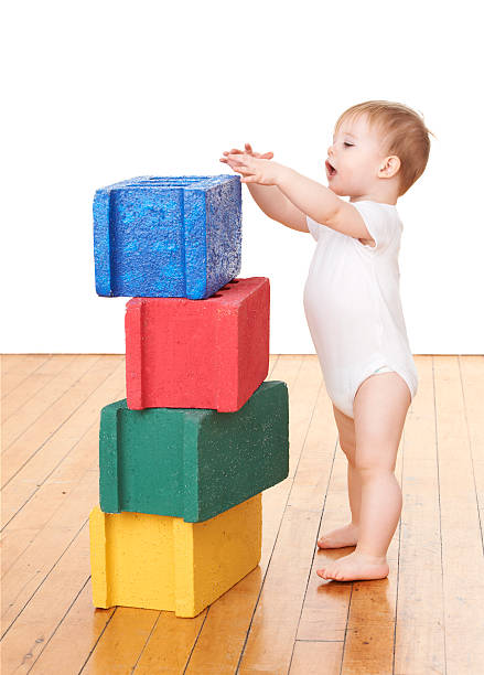 Toddler Playing With Blocks stock photo