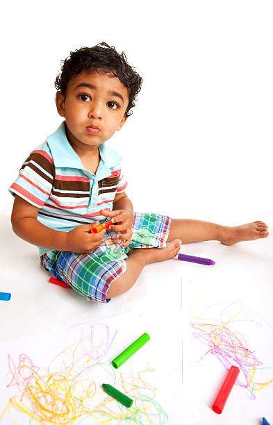 Toddler Playing with Crayons stock photo