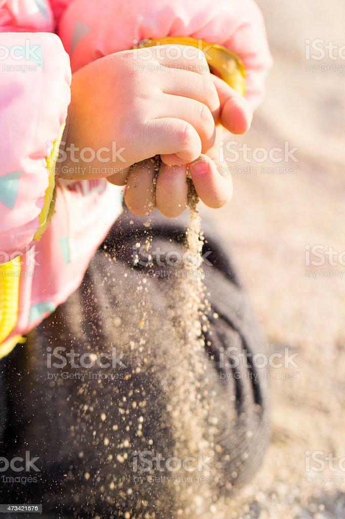 Toddler Playing with Sand stock photo