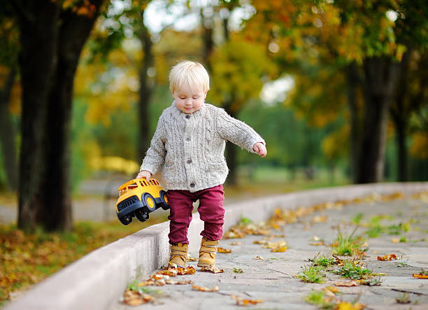 Royalty Free Toddler Picking Up Toys Pictures Images And Stock