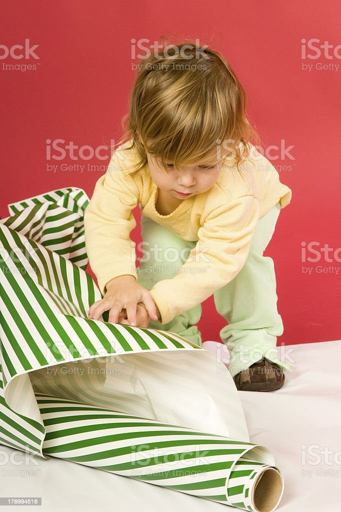 "Toddler ""Helping"" Wrap Presents royalty-free stock photo"