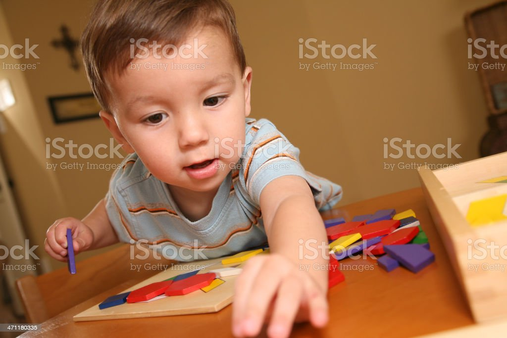 Toddler Reaching For a Toy royalty-free stock photo