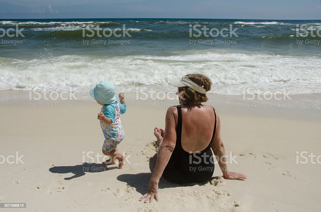 Toddler Runs Away on Beach stock photo