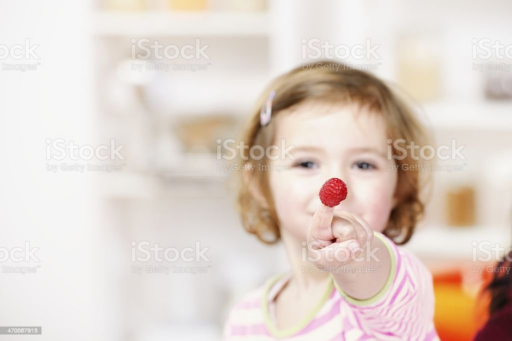 Toddler Showing Off Raspberry stock photo