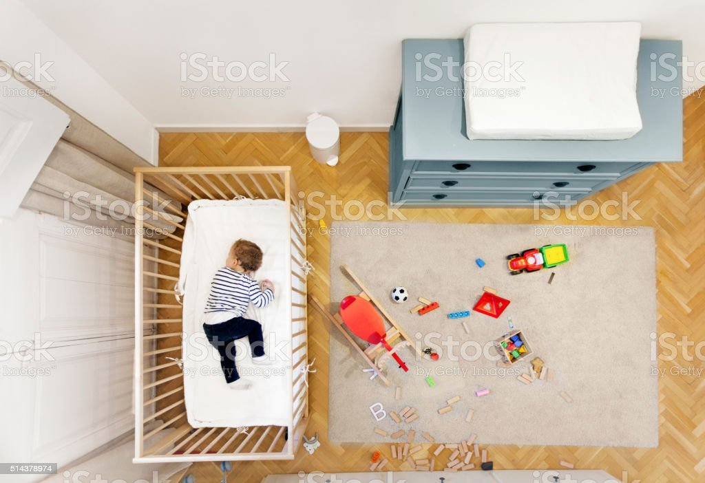 Toddler sleeping in his room stock photo