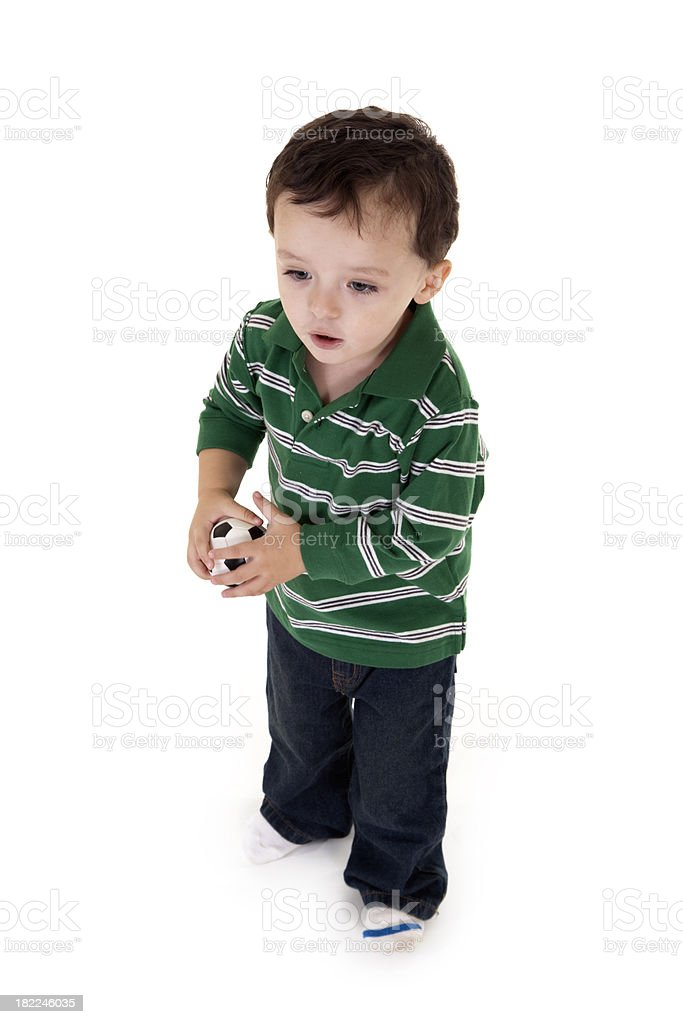 Toddler throwing a miniature soccer ball royalty-free stock photo