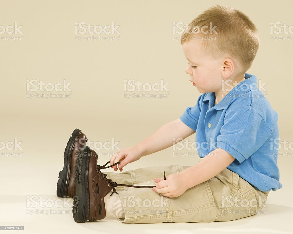 Toddler Tying Shoes stock photo